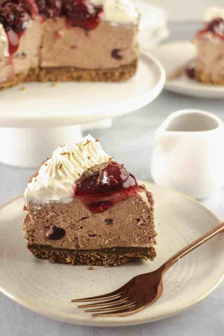 Slice of chocolate cheesecake with cherries on the top