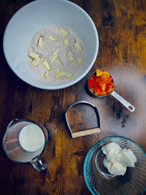chopped peaches, ricotta, butter in dry ingredients