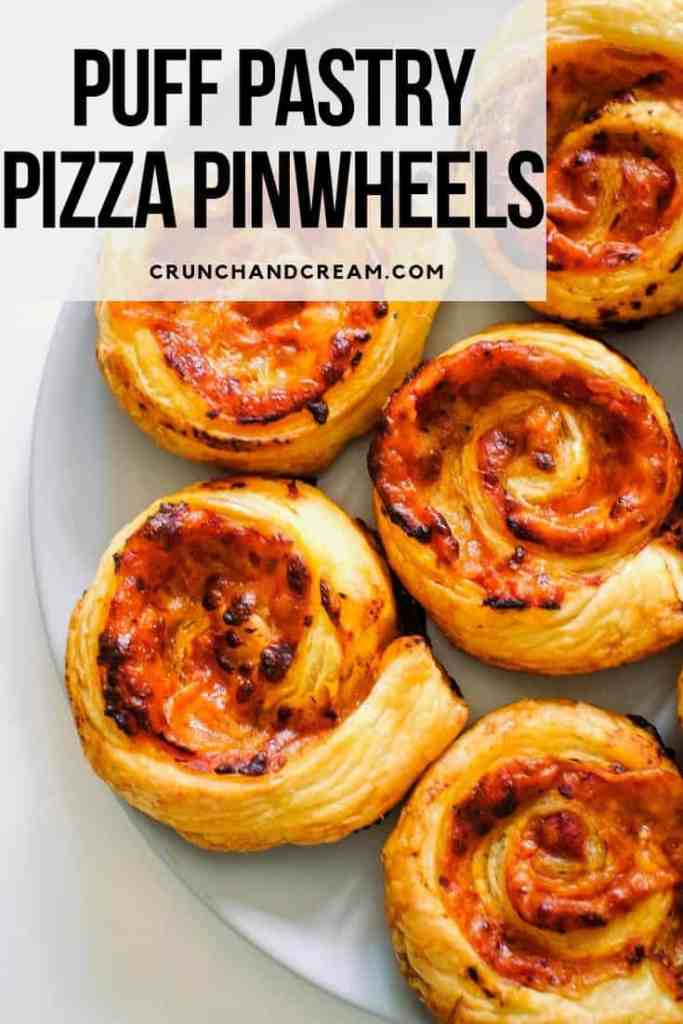 These pizza pinwheels are super quick and easy thanks to store-bought puff pastry. You can add all the toppings you like way beyond the basic sauce and cheese. Plus, they're re heatable and even delicious cold! #puffpastrypizzarolls #puffpastrypizzavegetarian #puffpastrypizzascrolls #puffpastrypizzapinwheels