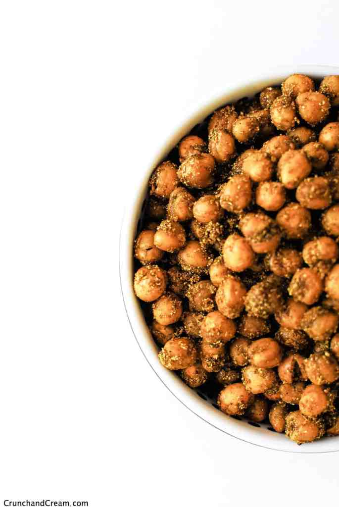 overhead of a bowl full of Indian spice-coated chickpeas