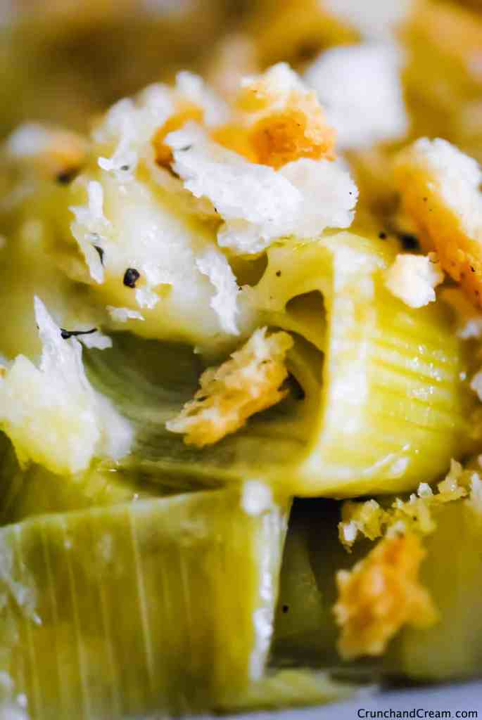 close-up of creamy leeks with a bechamel sauce and crispy breadcrumbs.