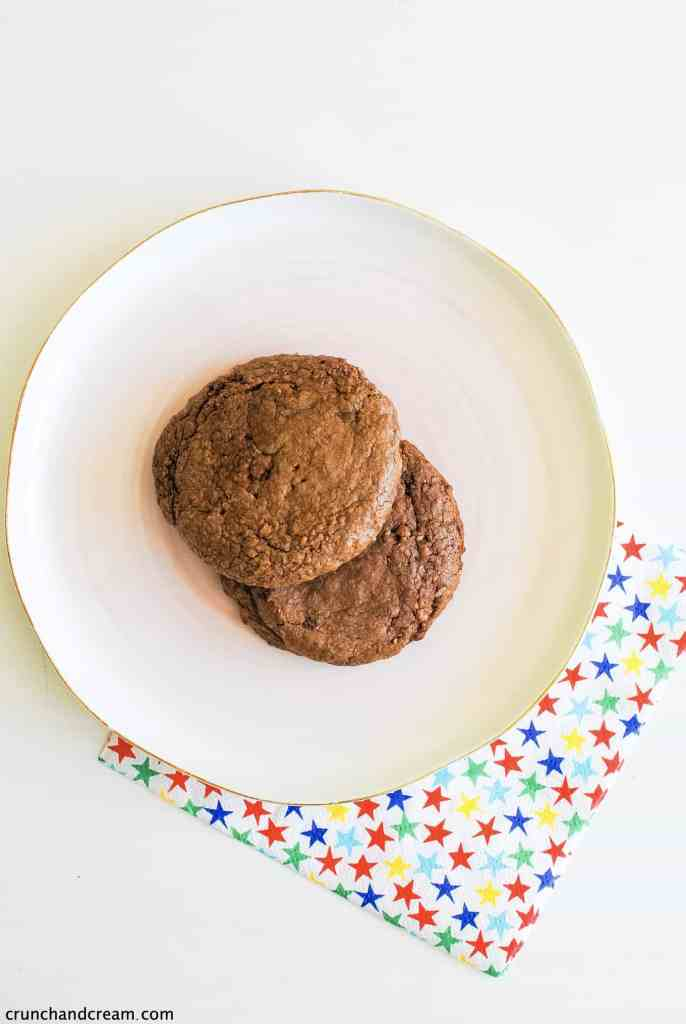 2 brown nutella cookies on a plate