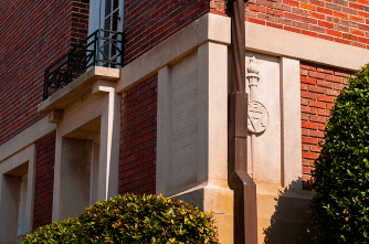 The cornerstone of the building featuring the YMCA crest.