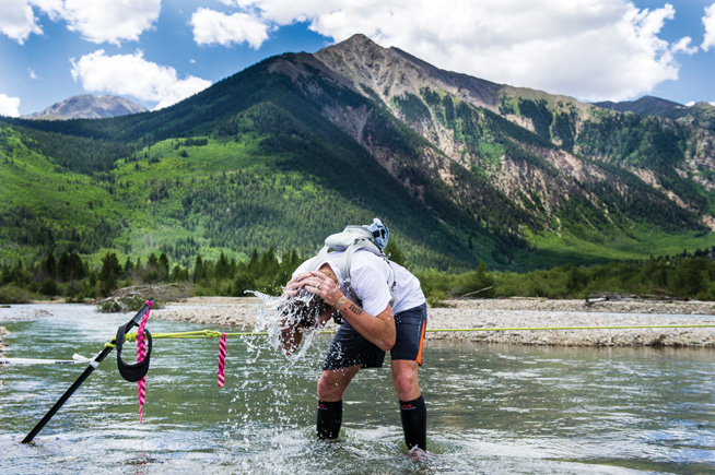 TWIN LAKES, CO - AUGUST 16:  Runner Tony Brown #104 washes his head in Lake Creek as runners make their way along Gordon Gulch during the 2014 Leadville Trail 100 ultramarathon on Saturday, August 16, 2014 in Twin Lakes, Colorado.  (Photo by Kent Nishimura/The Denver Post)