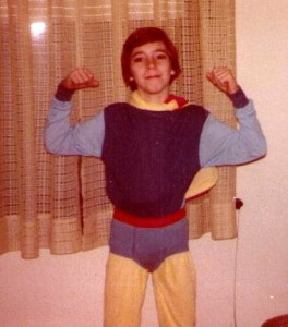Myself at age nine in a Captain Ultra-esque, rainbow-spectrum superhero suit of my own making, which was a mash-up of different sets of superhero pajamas and underoos.