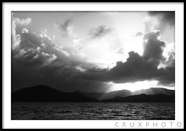 Rays of light shining through in the British Virgin Islands. Copyright Nate Young and Crux Photo.