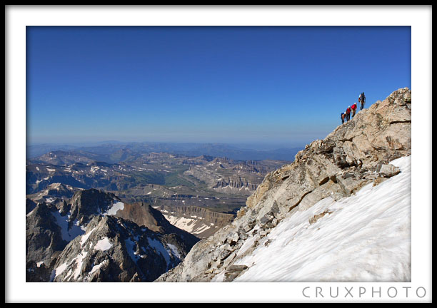 Sarah, Mary and Chelsea nearing the summit on the Exum Ridge.  Copyright Nate Young and Crux Photo.