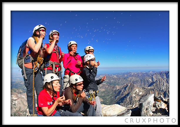 Kelly Perkins and the Stand on the Grand team make a wish for those waiting for organs on the summit.  Copyright Nate Young and Crux Photo.