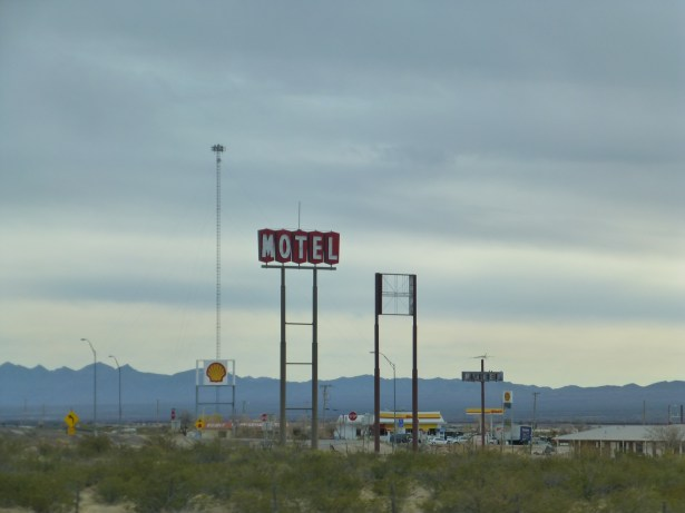 "I'm going to guess that the middle sign used to say ""MOTEL"""