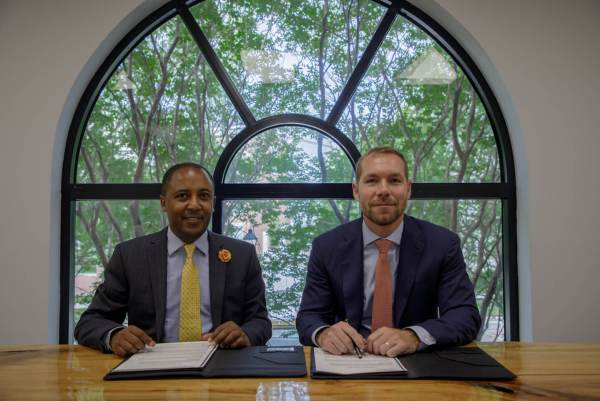 Figure 1 Zekarias Amsalu, Founder and Managing Director of IBEX Frontier LLC, and Leland Rice, CEO of Dedalus Global LLC, signing an MoU to jointly organize and execute the Africa Fintech Summit in Addis Ababa on November 21, 2019.