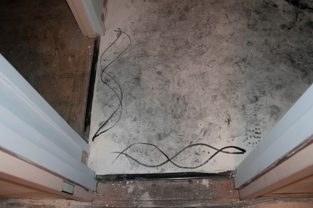 Title: Floor Drawing #2 Date: June 12th, 2013 Materials: Loose Graphite, black opaque ink, and liquid graphite on white painted floor. Drawing made on the day of the opening. My hypnotist hypnotized me in my studio, on 40 West 77th Street Apartment 1H, New York, NY. Drawing made in a hypnotic state.