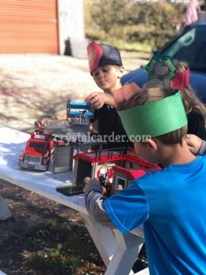 Make Playtime Fun with PLAYMOBIL and This Super Easy Fireman's Hat