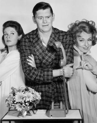 circa 1965: L-R: American actors Elizabeth Montgomery, Dick York, and Agnes Moorehead, all wearing sleepwear, looking at a telephone with a levitating receiver, in a still from the television show, 'Bewitched'. (Photo by Hulton Archive/Getty Images)