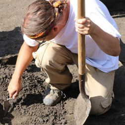 an archaeologist digging