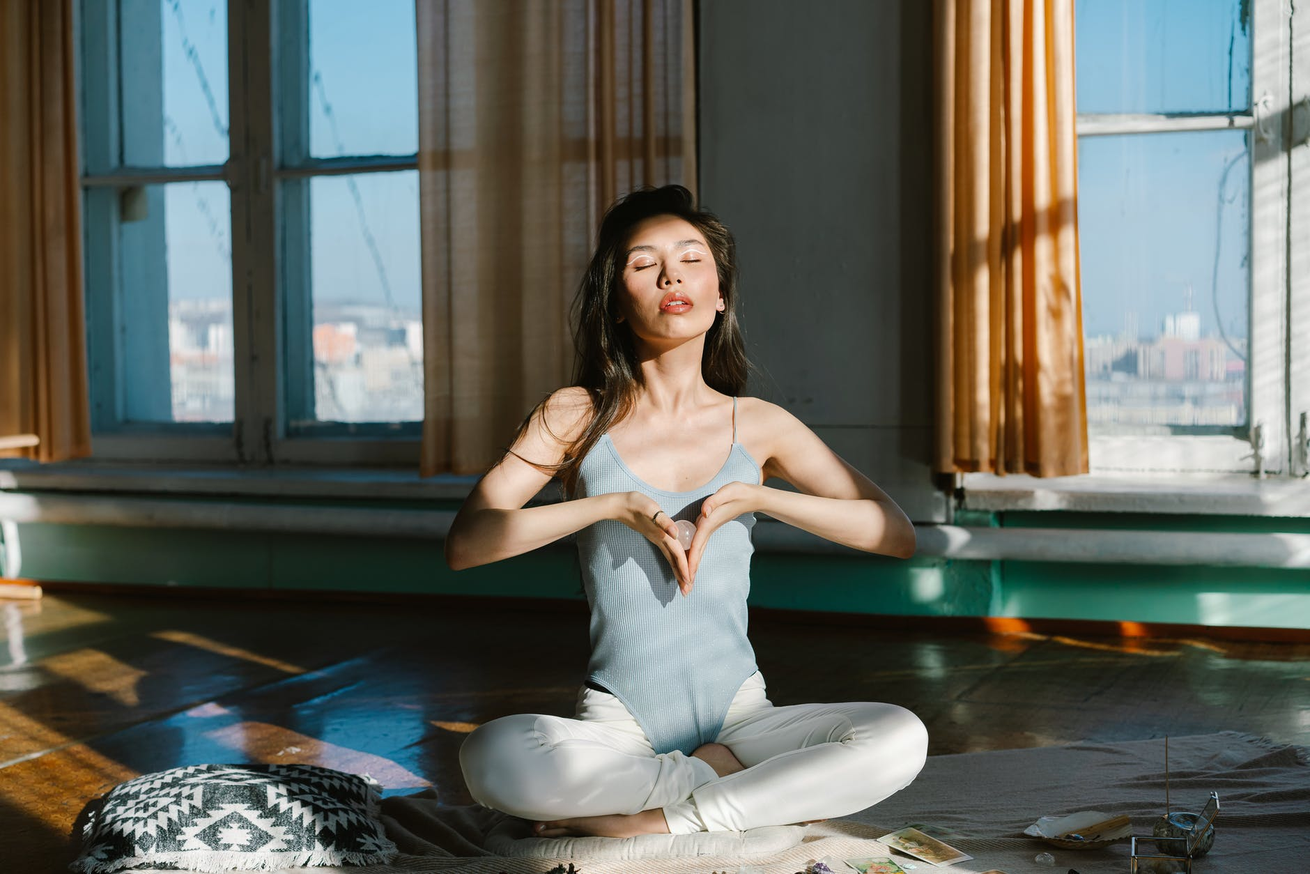 asian woman with stone practicing meditation