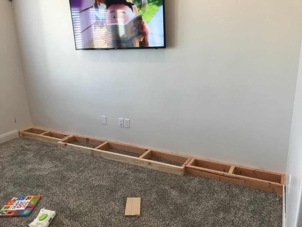 3 sets of 2x4 bases lined up against the wall