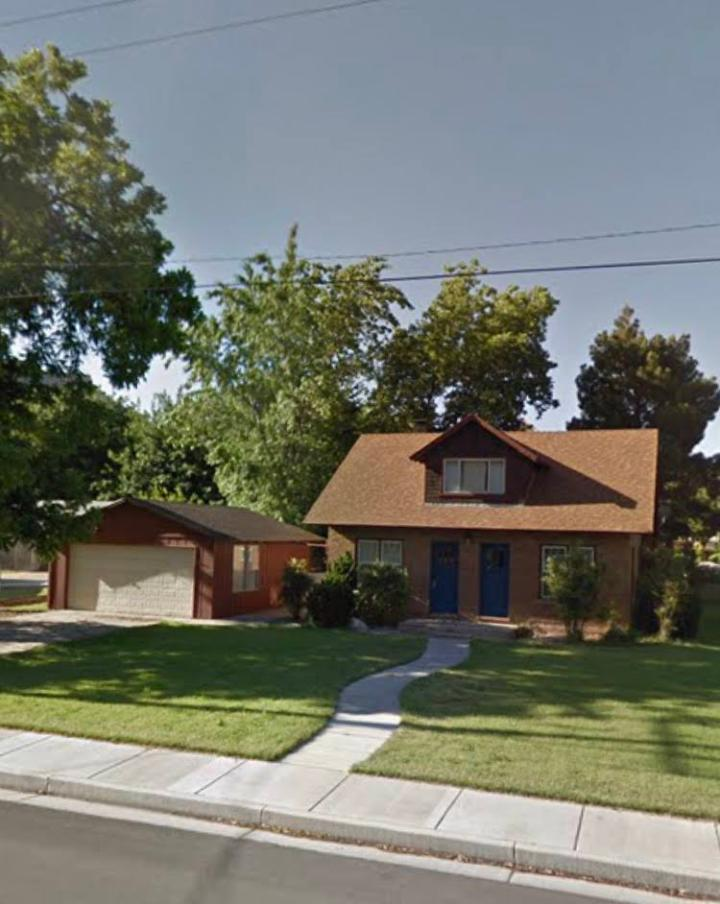 Brown house with red garage and two blue front doors before popout was built