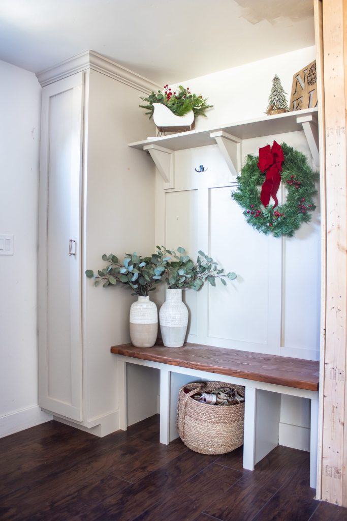 Finished mudroom entryway, painted gray decorated for christmas