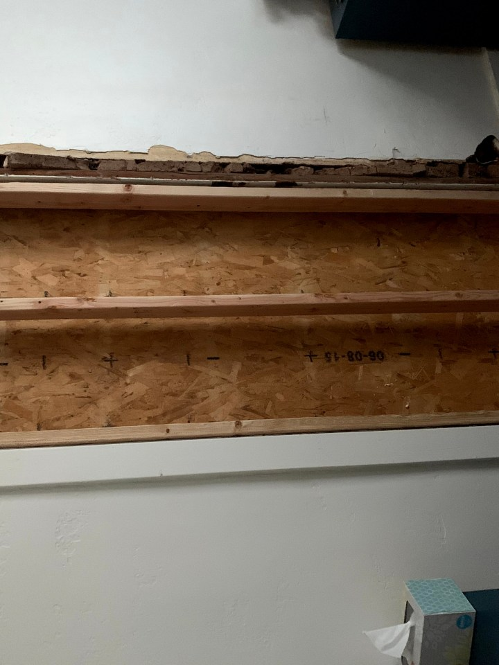 Interior view of door framed in with plywood behind it