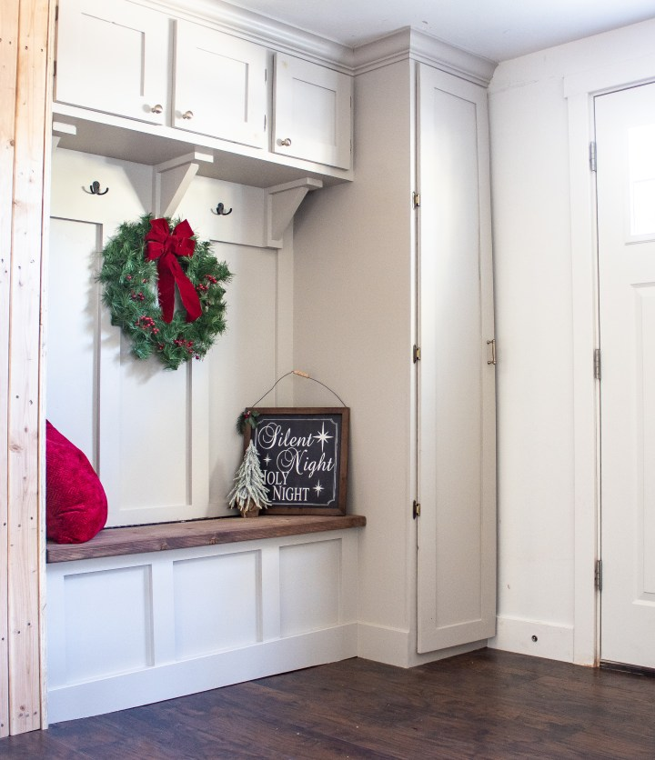 Completed painted mudroom with doors installed and christmas decor