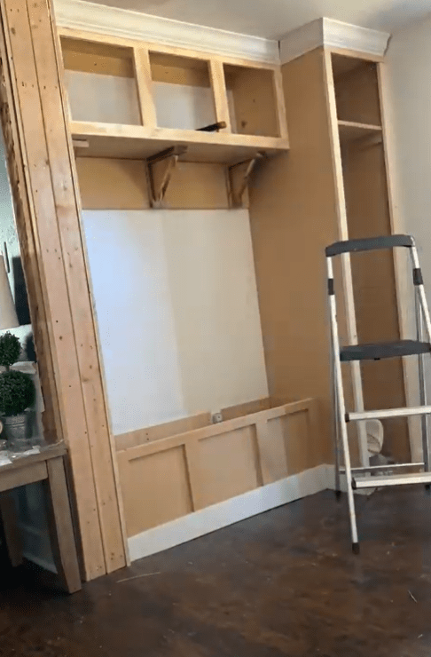 mudroom progress with completed crown molding and bench trim
