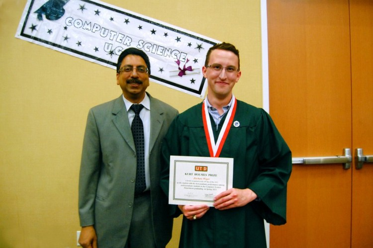 Zackary Weger accepting the Inaugural Kurt Holmes Award from Dr. Gupta, the UT Dallas Computer Science Department Head.