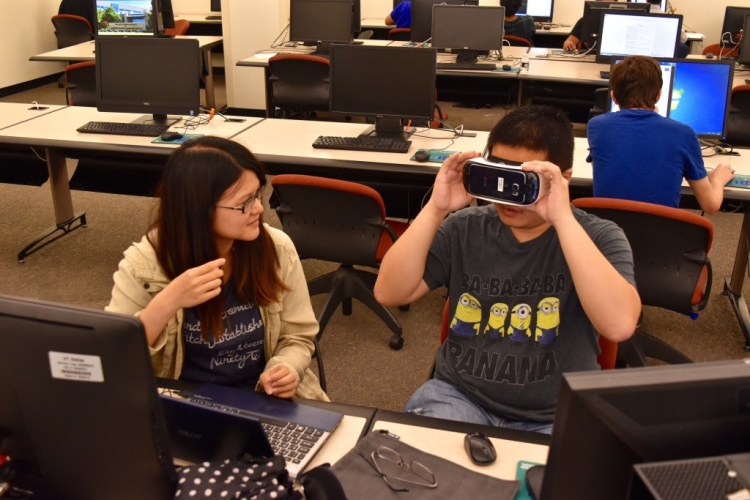 Chih Wei and Man-lin Ku, both Dr. McMahan's VR students, work in the lab on their project.