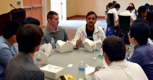 Computing Scholars (CS2) students chat with  Puneet Maheshwari.