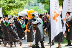 """""""Temoc is my everything!"""" Trey Smith's warm embrace said it all when he saw his favorite mascot after his commencement ceremony. Smith earned a bachelor's degree in computer engineering."""