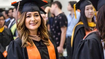 New School graduates make a beeline for the gym, where they received their hard-earned diplomas.