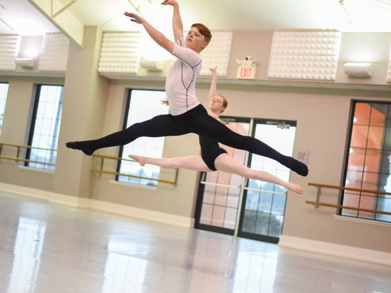 Students doing Saute De Shat at Columbia Summer Ballet Intensive