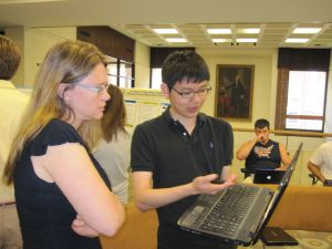 Paul Jang '15 demonstrates the Ancient Graffiti project to Professor Janelle Gertz
