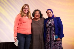 Poster co-chairs Sara Sprenkle (left) and Kaoutar El Maguari pose with Barbara Gee during the opening session.