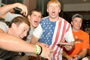 Left to right, Connor Case, 18, freshman of Rapid City, S.D., Andrew Rios, 18, freshman of Lexington, Zach Sandstrom, 18, freshman of Chadron, and Shane Hadley, 18, freshman of Moorcroft, Wyo., explode with excitement Sept. 16 during the pingpong tournament hosted by the Pit. — Photo by Vera Ulitina