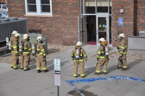 Chadron firefighters stand outside the front entrance of Miller Hall after receiving an emergency alarm signal Monday, February 14. — Photo by Chelsie Moreland