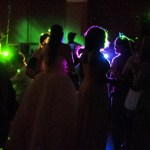 The laser lights illuminate the masked CSC students at Mardi Gras Dance on Friday February 24th. — Photo by Karisa Lamle