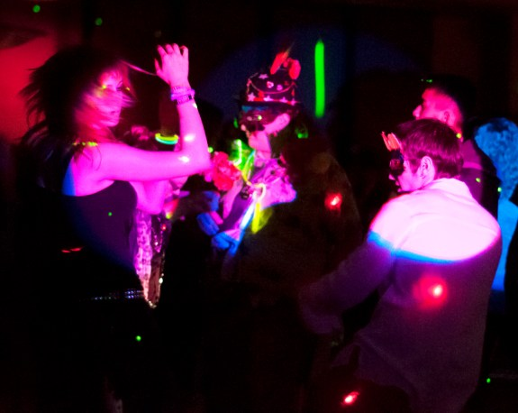 Masked CSC students move and groove to the dance beats at the Mardi Gras Dance, Friday, February 24th. — Photo by Karisa Lamle