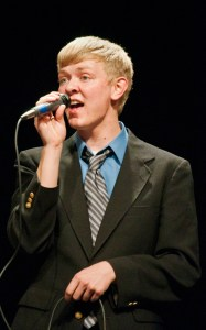 """Lane Swedburg, freshman of North Platte, sings """"All, or Nothing at All,"""" composed by Bobby Caldwell, during the Vocal Jazz Ensemble, Tuesday in the Memorial Hall Auditorium. — Photo by Ashley Swanson"""