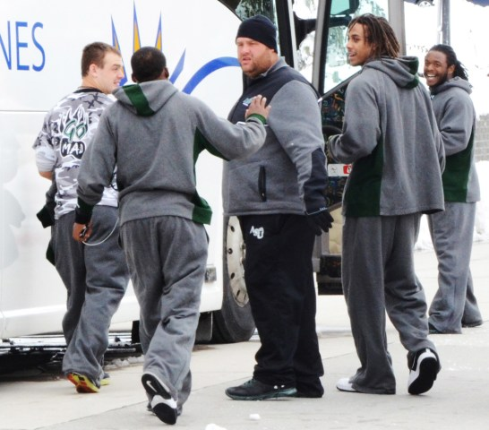 Football players from Adams State University load onto a bus Saturday, after a walk-through in the Nelson Physical Activity Center. — Photo by Spike Jordan