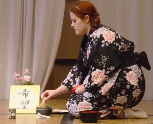 Analise Garland, freshman of Wall, S.D., performs a traditional Japanese tea making demonstration during the International Food Tasting Party, Saturday in the Student Center Ballroom. —Photo by Teri Robinson