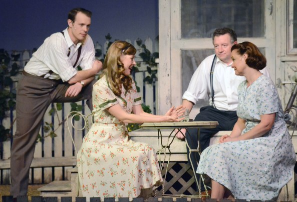 """From left, Chris Keller, played by Colton Swinbold; Ann Deever, played by Meg Kiley Smith; Joe Keller, played by Mike Boland; and Kate Keller, played by Laurie Dawn, talk about Deever's new home and why she hasn't gotten married yet in the play """"All My Sons"""" by Arthur Miller performed on Feb. 10 in Memorial Hall. —Photo by Sara TweetAll My Sons"""" by Arthur Miller, Chris Keller played by Colton Swibold, Ann Deever played by Meg Kiley Smith, Joe Keller played by Mike Boland, and Kate Keller played by Laurie Dawn on Wednesday night in Memorial Hall."""