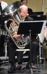 CSC alum Jim Grimes plays the tuba in the Campus and Community Band Monday in the Memorial Hall Auditorium. —Photo by Melanie Nelson