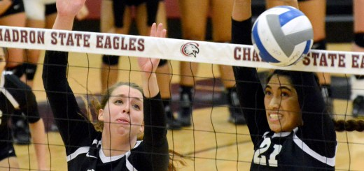 Alia Brennan (12), senior of Chadron, and Rudy Leasau (21), senior of LaMesa, California, attempt to block a spike Saturday at the volleyball game against Black Hills State University, Spearfish, South Dakota, at the Chicoine Center. —Photo by Justine Stone
