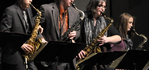 Part of the six person saxophone section, from left, senior Drew Kasch, of Highlands Ranch, Colorado; junior Jedd Raymond, of Ainsworth; sophomore Bryony Trump, of Sterling, Colorado; and freshmen Cierra Pfanstiel, of McLean, play their saxophones during the Jazz Band Performance in Memorial Hall on Tuesday. —Photo by Torri Brumbaugh