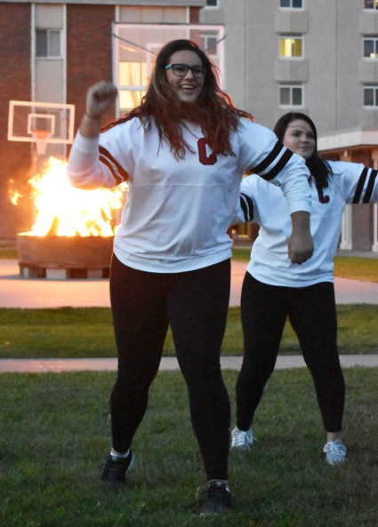 Rose MacClure, junior of Whiting, Iowa, and the CSC Dance Team perform at the Spirit Rally and Bonfire Monday night at the Backyard.