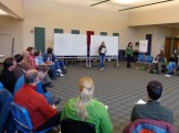 Staff members participate in a discussion.