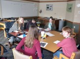Annie, Drew, Sarah T., Emily, and Emma discussing bird feeding and monitoring