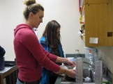 Kierra and Erin washing planters