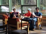 Bri, Grant, Annie, and Shane read in the Gathering Space.