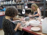 Maren and Cassidy work on their bowls.